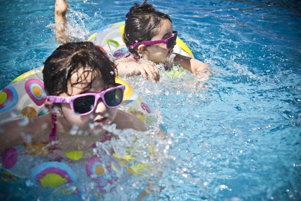kids swimming in the pool