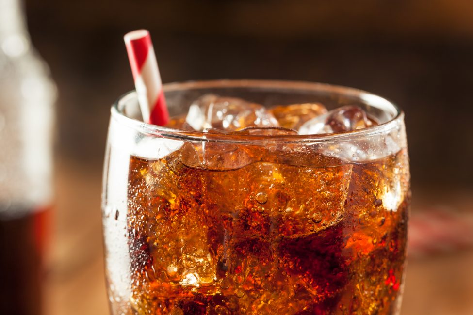 fountain soda in a glass with a straw